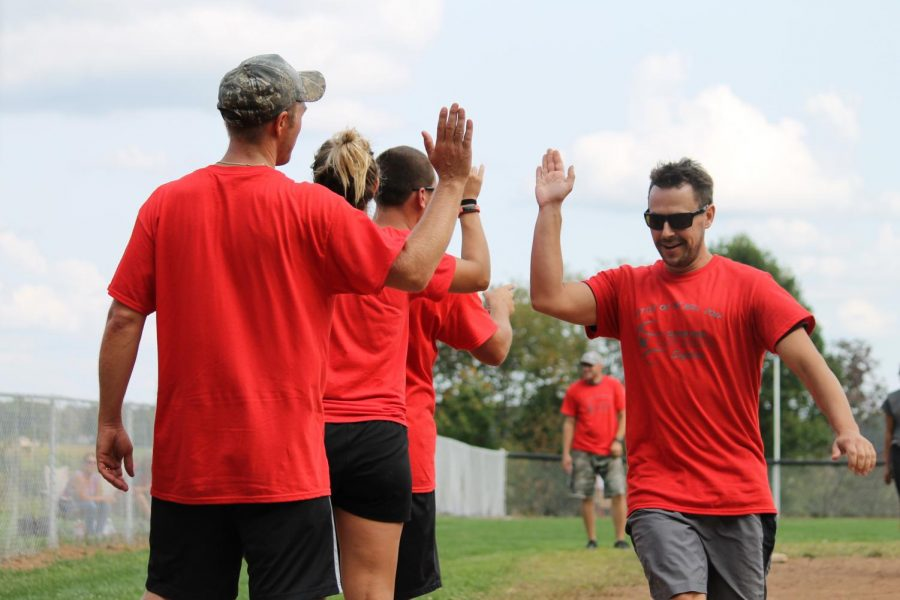 Mr. Belowich celebrates a teacher team victory at the first annual Battle on the Hill girls softball fundraiser.