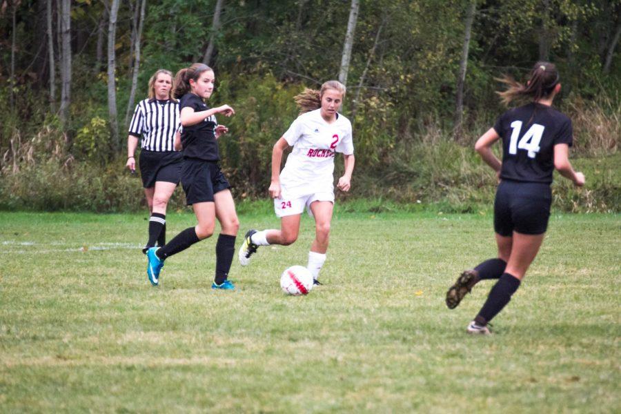 Girls soccer member sophomore Emily Raine kicks the ball away from Hickory, the opposing team.