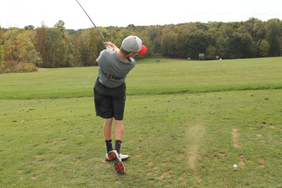 Chad Green warms up at the drive range in Oakview.