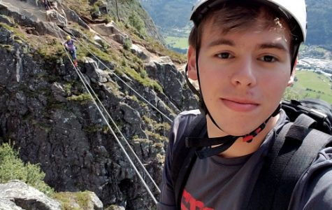 Ben Shumway takes a Selfie while rock climbing.