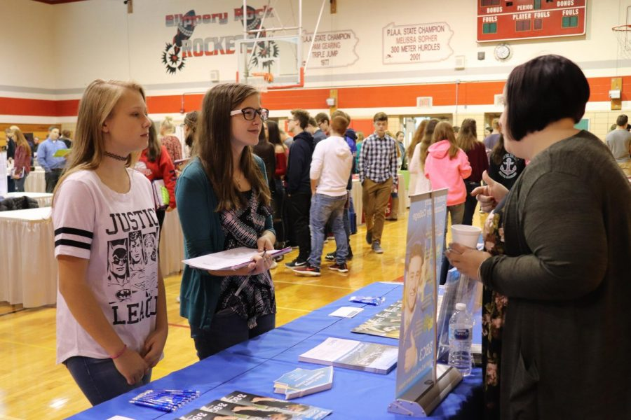 Grace Sybert and Katy McWhorter discuss college opportunities at one of the career fair booths.