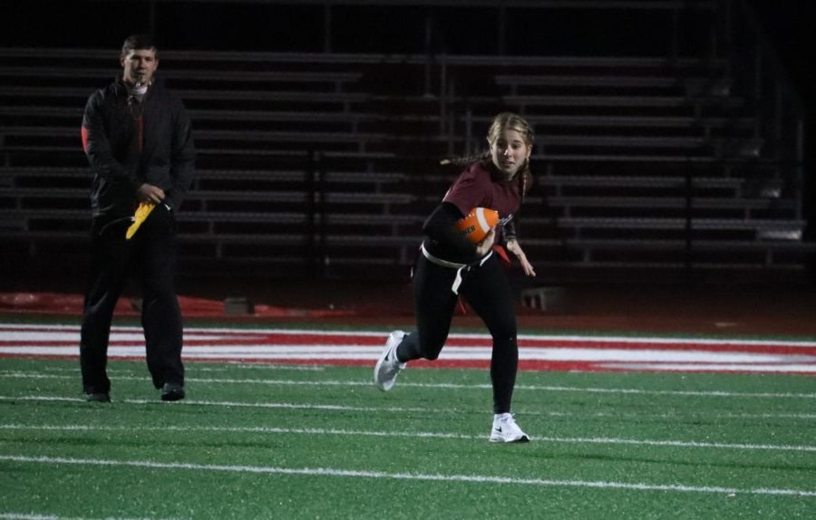 Senior Hannah Wilson runs with the ball for a touchdown.