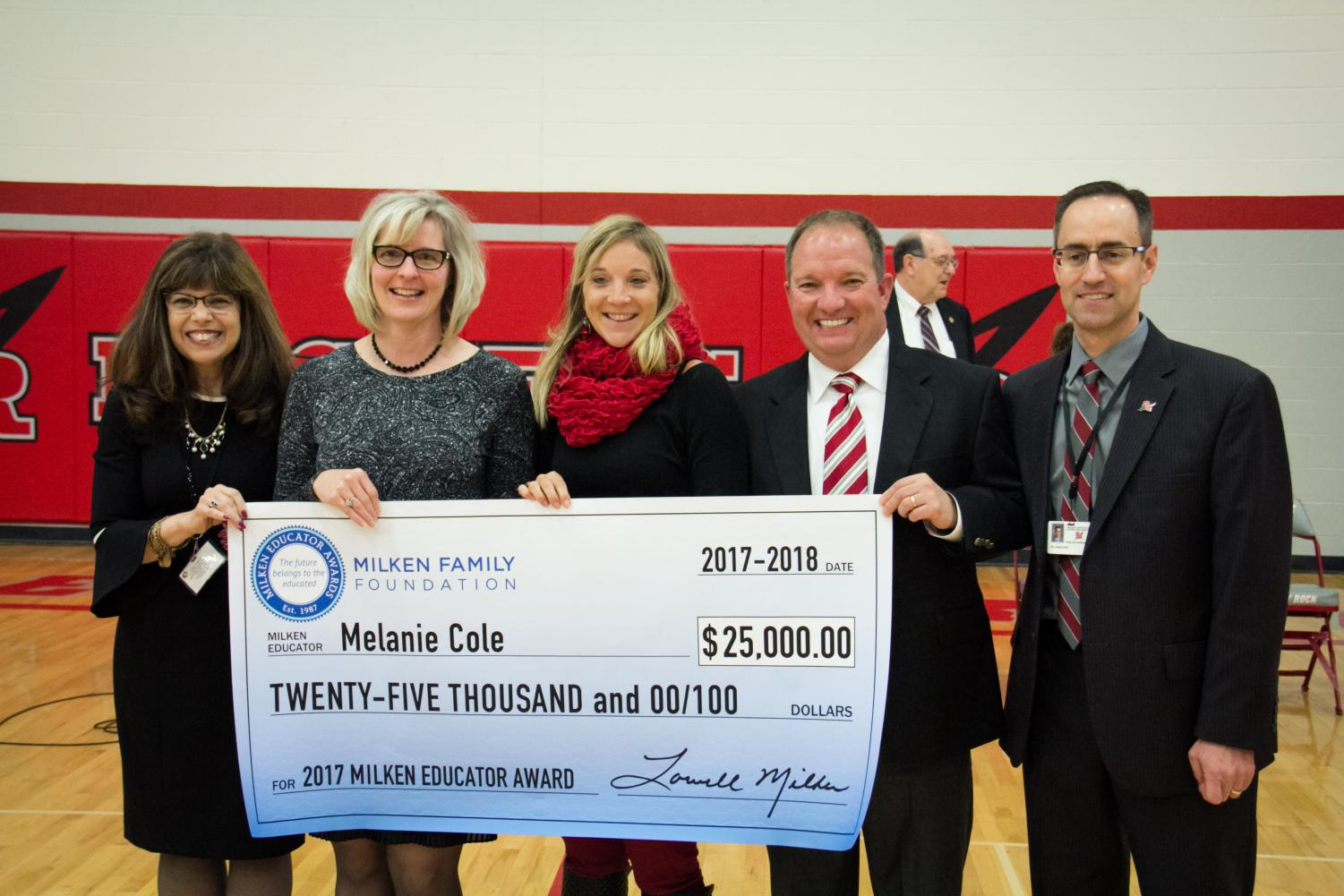 Mrs. Cole accepted the Milken Educator award as administrators Dr. Kardambikis, Mrs. Czubiak, Mr. Hake, and Dr. Angelucci congratulate her.