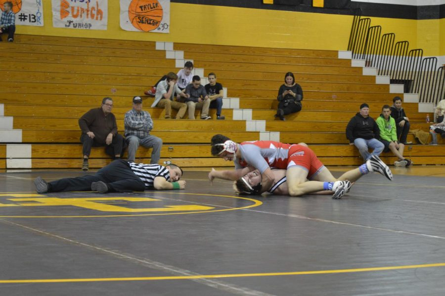Junior Kaleb Kamerer pins a 182-pound wrestler from the Grove City Egales team.