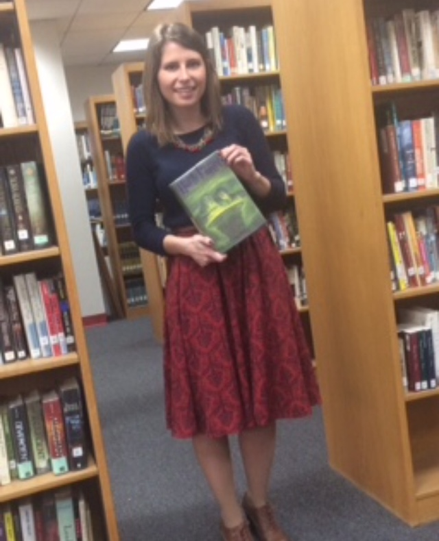 Ms. Hegarty holds Harry Potter and the Half-Blood prince, which is a book from one of her favorite series.