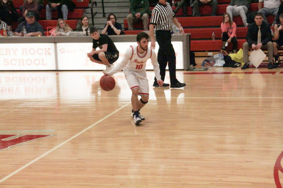 Junior Oliver Valera dribbles down court in the game against the Grove City Eagles.