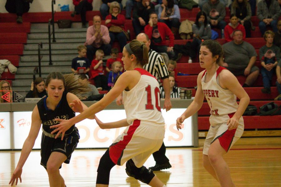 Freshman Maryann Ackerman helps Junior Emma McDermott keep the other team from scoring.