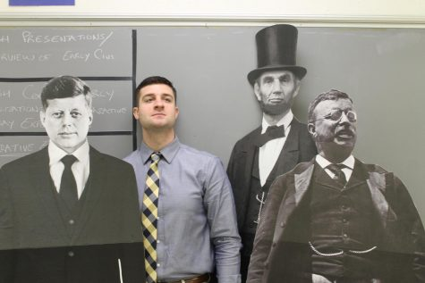 "Mr. Miller stands proudly with his favorite president, TR, along with some other great leaders of our country. Miller said Roosevelt is his favorite president because of how he influenced the people of the United States. ""The way he could motivate people is definitely inspiring to me,"" he said.  Photo by Kenneth Foran"