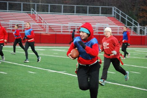 "Rush it! Sophomore Maryann Ackerman runs the ball down the field. The Turkey Bowl happened on November 20th. ""I just wanted to get to Irene."" said Maryann. Photo by Olivia Tiche"