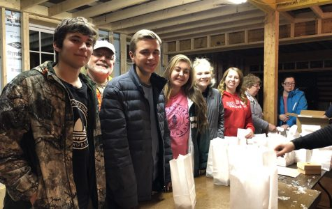 Light it Up! Nate Gill, Garrett Galcik , Mekenzie Pfluger, Ashley Rodgers, and Morgan Malinski make luminaries for the Prospect Rotary Club. Photo by Mackenzie McMillin