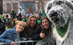 Luck o' the Irish. Makenzie Callihan, Meckenzie Pflueger, and Jordyn Kreutz pose for a photo with Finn the Irish Wolfhound, the mascot for Pittsburgh's St. Patrick's Day parade. The girls attended the parade on March 16th. Photo courtesy of Meckenzie Pflueger.