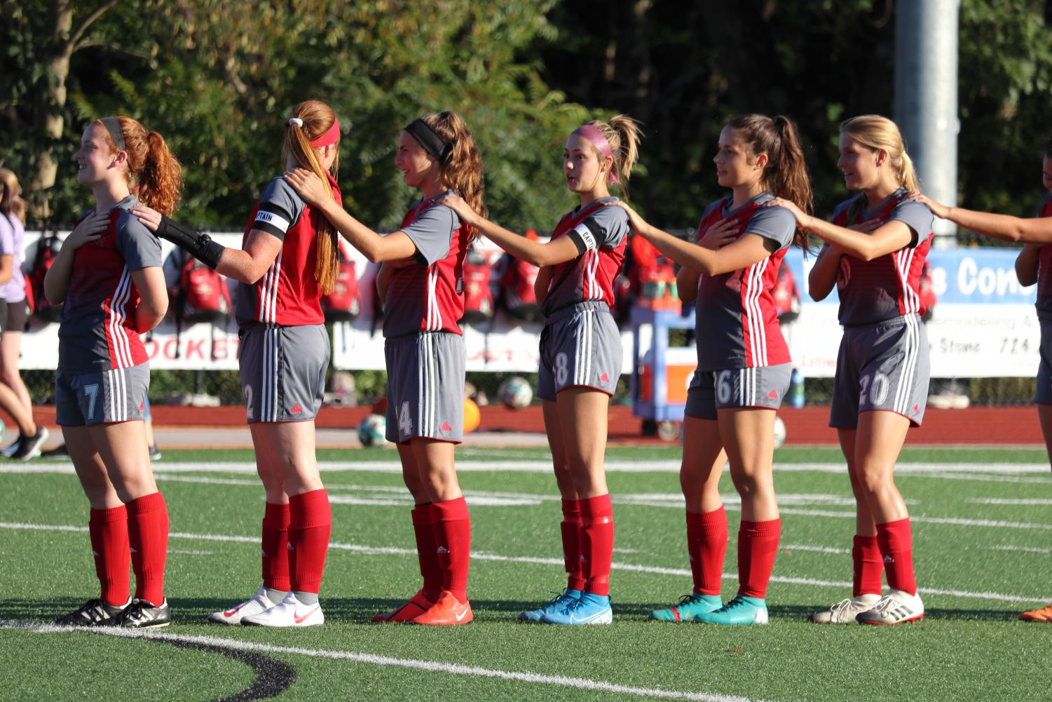 The girls soccer team links together, an annual tradition at the home game versus Grove City on September 6, 2019.