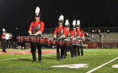 Members of the drumline, including senior Greg Pritts and junior Christian Shaffer, play the tenors during the Grove City College Marching Band Invitational on October 12.