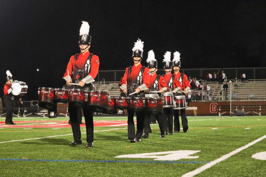 Members+of+the+drumline%2C+including+senior+Greg+Pritts+and+junior+Christian+Shaffer%2C+play+the+tenors+during+the+Grove+City+College+Marching+Band+Invitational+on+October+12.